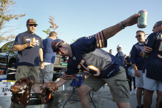 Could this be you? Chicago Bears fans tailgate prior to the game on Sept. 5  against the Green Bay Packers at Soldier Field.