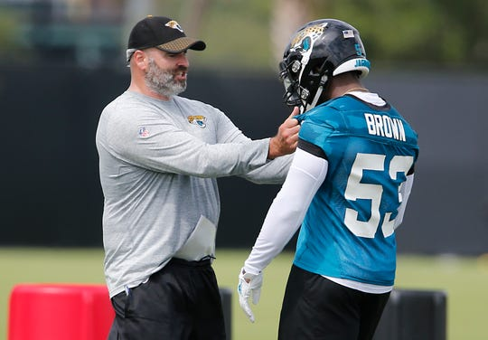 Jacksonville Jaguars linebacker Blair Brown (53) gets instruction from Jacksonville Jaguars linebackers coach Mark Collins during training camp at the Dream Finder Homes practice facility outside of TIAA Bank Field, on July 26, 2018.