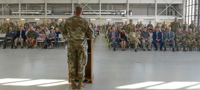 Deploying Louisiana National Guard soldiers with G Company and D Company, 2nd Battalion, 238th Aviation Regiment, recite the Soldier's Creed during a ceremony at Esler Field in Pineville Friday.