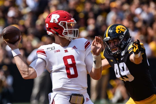 Sep 7, 2019; Iowa City, IA, USA; Iowa Hawkeyes linebacker Nick Niemann (49) rushes Rutgers Scarlet Knights quarterback Artur Sitkowski (8) during the third quarter at Kinnick Stadium. Mandatory Credit: Jeffrey Becker-USA TODAY Sportss