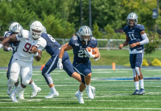 Monmouth's Pete Guerriero, who ran for 157 yards against Lafayette, looks for running room on Saturday. Monmouth won, 24-21.