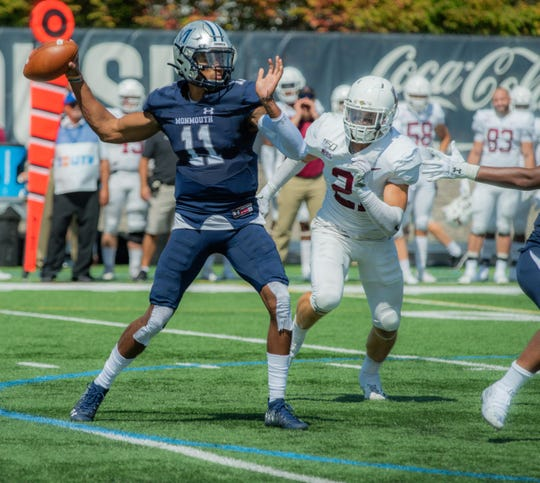 Monmouth quarterback Kenji Bahar throws a pass during the Hawks' 24-21 win over Lafayette on Saturday.