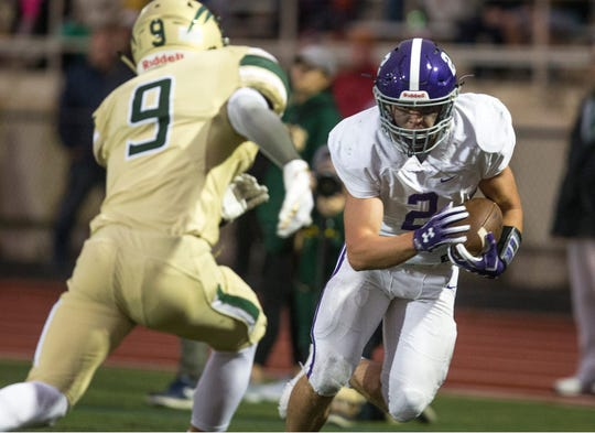 Rumson-Fair Haven's John Volker scores a touchdown on a pass reception Friday night in the Bulldogs' 20-14 win over Red Bank Catholic.