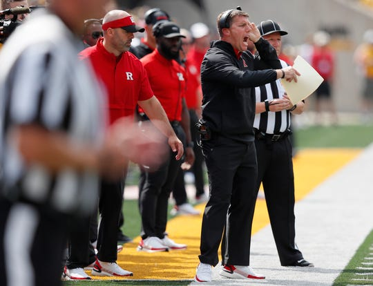 Rutgers head coach Chris Ash directs his team during the first half of an NCAA college football game against Iowa, Saturday, Sept. 7, 2019, in Iowa City. (AP Photo/Matthew Putney)