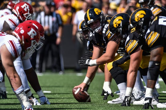 Sep 7, 2019; Iowa City, IA, USA; Iowa Hawkeyes center Tyler Linderbaum (65) holds the ball at the line of scrimmage against the Rutgers Scarlet Knights during the second quarter at Kinnick Stadium. Mandatory Credit: Jeffrey Becker-USA TODAY Sports
