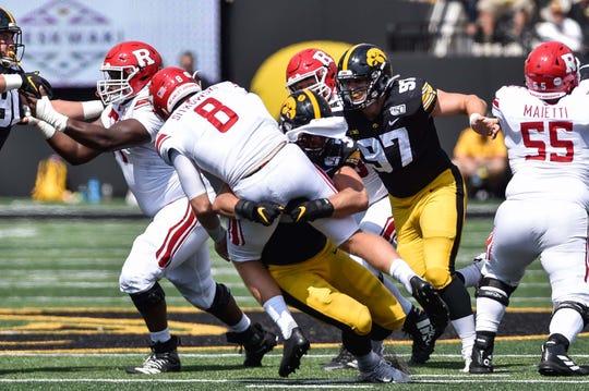 Sep 7, 2019; Iowa City, IA, USA; Iowa Hawkeyes linebacker Kristian Welch (34) tackles Rutgers Scarlet Knights quarterback Artur Sitkowski (8) during the third quarter at Kinnick Stadium. Mandatory Credit: Jeffrey Becker-USA TODAY Sportss