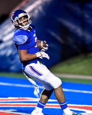Noah Garcia scores a touchdown in Cooper's 42-14 victory over Grapevine on Friday at Shotwell Stadium.