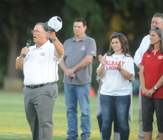 Albany football coach Denney Faith tips his cap to the home crowd before a game against Dublin on Friday, Sept. 7, 2019, at Robert Nail Memorial Stadium in Albany.