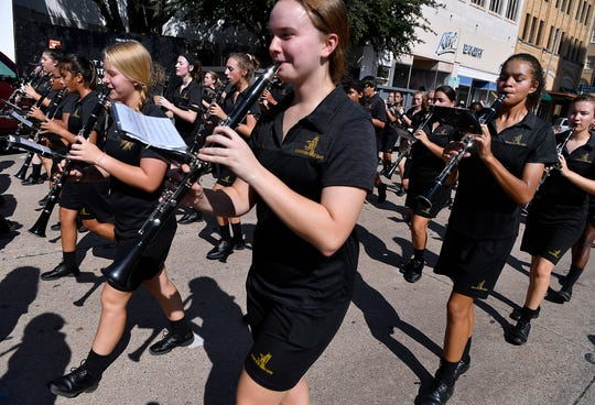 Members of the Abilene High School Eagle Band perform during the West Texas Fair & Rodeo Parade on Saturday.