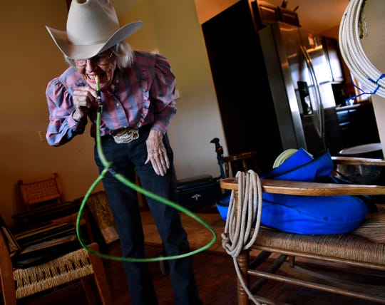 Virginia Reger proves she's still got it, demonstrating one of the trick ropes in the family collection at her home in Hawley August 29. Reger, 92, was raised in the rodeo, as were her children.