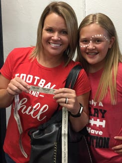 Pisgah 2001 graduate Ateia Johnson won $14,500 in the 50/50 raffle at the Sept. 6 Pisgah-Tuscola football game