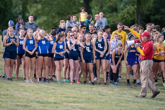Area girls varsity X-Country teams listen to the starters instruction before the start of the Lakeview X-Country Invitational on Saturday, September 7, 2019.