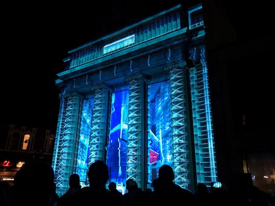 """One Giant Leap"" by favorite color was projected on 49 Court St. as part of the LUMA Projection Arts Festival."