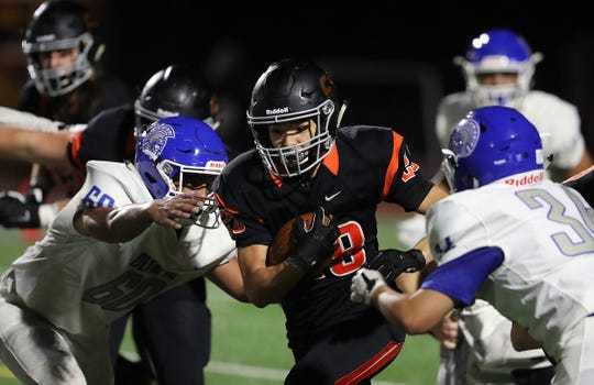 Central Kitsap's Joshua Willis runs the ball against Olympic during the Cougars' Week 1 win over Olympic. Willis is one of several starters who hasn't been able to play recently due to injury.