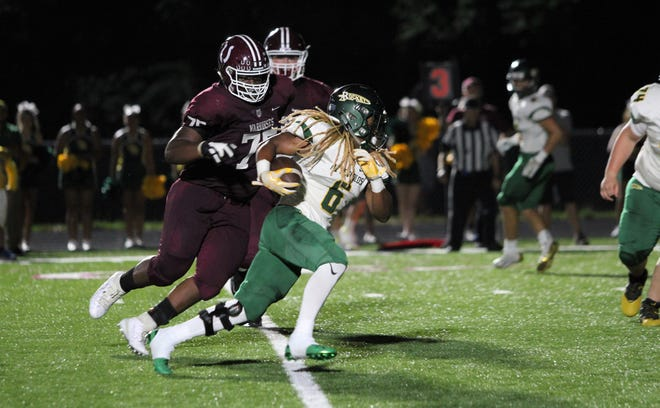 Owen senior defensive tackle Saevion Gibbs closes on Reynolds senior Don Mosely. The Rockets dominated the Warhorses, 35-3, in Owen's home opener on Sept. 6.
