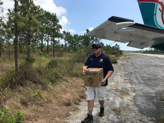 Florida State Rep. Randy Fine offloads supplies on Grand Abaco in the Bahamas.