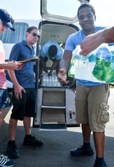Volunteers load one of five planes, including the Tico Belle, with relief supplies destined for the Bahamas