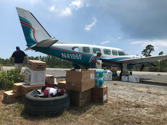 Supplies are offloaded from a Navajo airplane out of Melbourne on Grand Abaco in the Bahamas.
