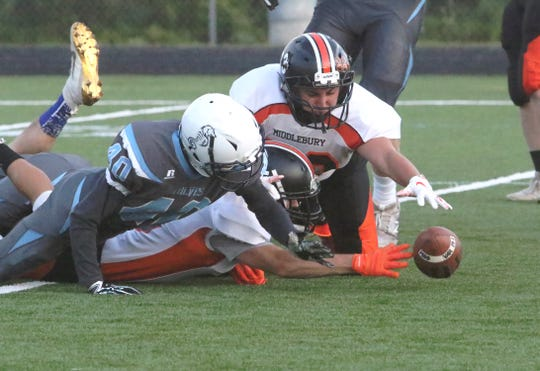 Members of both Middlebury and Burlington/South Burlington battle for a loose ball early in the Tigers 49-20 defeat of the Sewolves on Friday night.