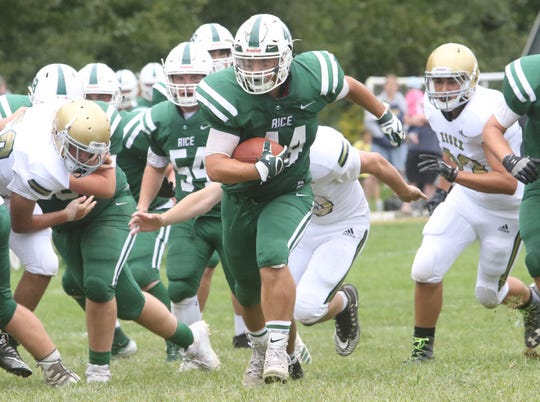 Rice senior Will Bond blasts through the Hornets defensive line for a big gain during the Green Knights' 36-6 loss to Essex on Saturday.