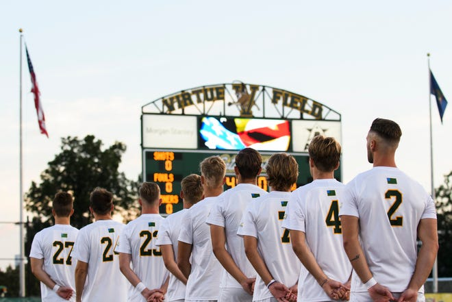 The teams listen to the National Anthem  during the men's soccer game between the Iona Gaels vs. Vermont Catamounts at Virtue Field on Friday night September 6, 2019 in Burlington, Vermont.
