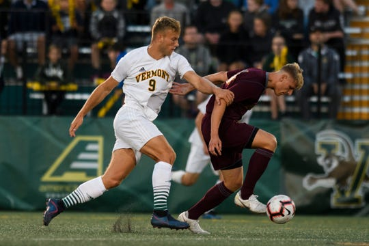 Vermont's Rasmus Tobinski (9) battles for the ball during the men's soccer game between the Iona Gaels vs. Vermont Catamounts at Virtue Field on Friday night September 6, 2019 in Burlington, Vermont.