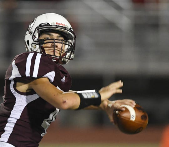 Sinton's Rene Galvan prepares to throw the ball at the game against Miller, Friday, Sept. 6, 2019, in Sinton. Galvan completed the pass.