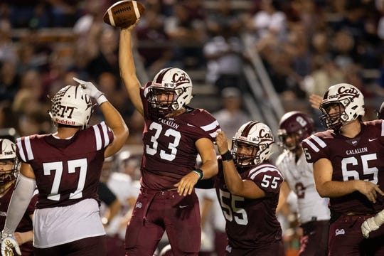 Calallen's Jacob Chambliss holds up the ball after recovering a fumble during the third quarter of their game against Flour Bluff at Wildcat stadium on Friday, Sept. 6, 2019.