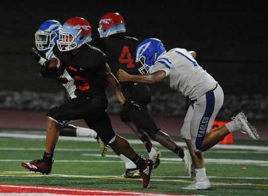 Pennsauken's Ejani Shakir runs with the ball after making a reception during Friday night's 32-13 win over Paul VI.