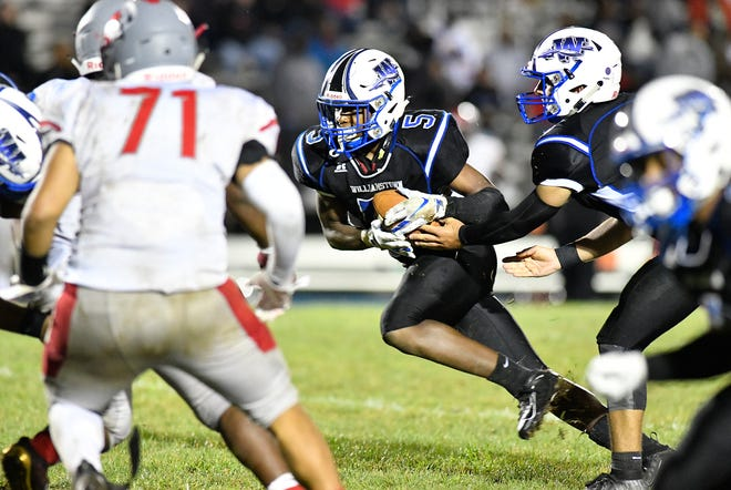Williamstown's Doug Brown hands off to Turner Inge during a game against Vineland. The Braves topped the Fighting Clan, 28-7, on Friday, September 6, 2019.