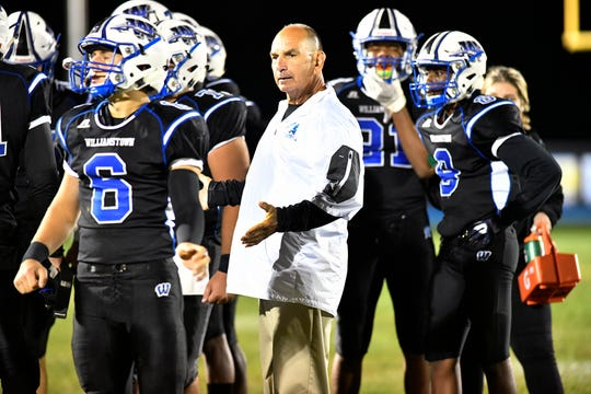 Braves coach Frank Fucetola talks to his players during the second quarter. The Williamstown High School football team defeated visiting Vineland, 28-7, on Friday, September 6, 2019.
