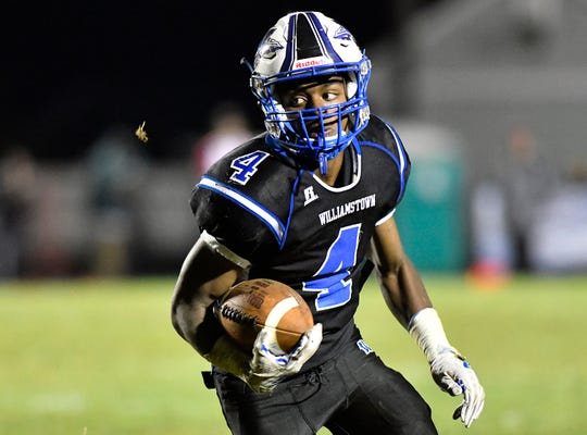 Williamstown's Chris Forman runs for a short gain against Vineland. The Braves topped the Fighting Clan, 28-7, on Friday, September 6, 2019.