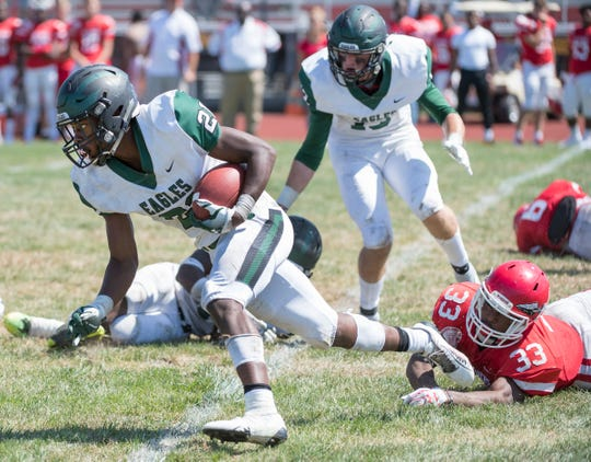 West Deptford's Kameron Dixon runs the ball after making an interception during the 3rd quarter of the football game between West Deptford and Paulsboro, played at Paulsboro High School on Saturday, September 7, 2019.  West Deptford defeated Paulsboro, 31-14.
