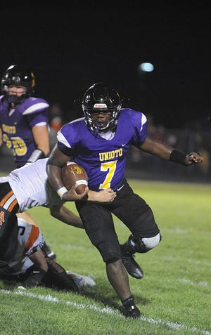 Unioto's Jamarcus Carroll runs the ball during the Shermans' 32-14 loss to Amanda-Clearcreek at Unioto High School in Chillicothe, Ohio on Friday Sept. 6, 2019.