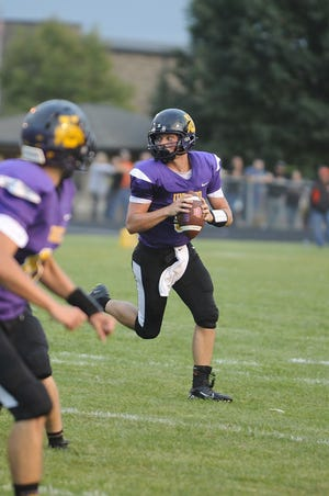 Unioto's Isaac Little rolls out of the pocket during a 32-14 loss to Amanda-Clearcreek at Unioto High School in Chillicothe, Ohio on Friday Sept. 6, 2019.