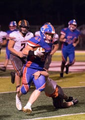 Zane Trace's Cougar Stauffer runs the ball in a 49-14 loss to Waverly on Friday, Sept. 5, 2019, at Zane Trace High School.