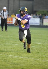 Unioto quarterback Isaac Little runs the ball during a 32-14 loss to Amanda-Clearcreek at Unioto High School in Chillicothe, Ohio on Friday Sept. 6, 2019.