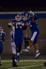 Chillicothe's Braedon Jones (14) celebrates with Brandon Williams (21) during Chillicothe's 27-14 win over Mifflin on Friday, Sept. 5, 2019, in Chillicothe, Ohio.