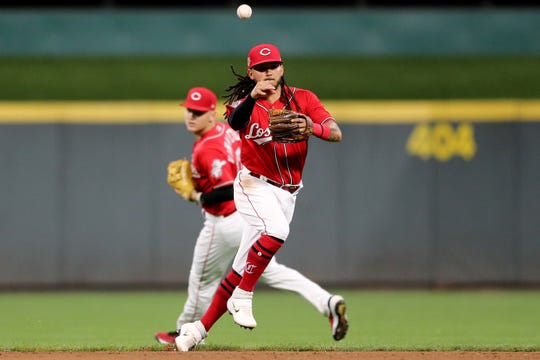 Cincinnati Reds shortstop Freddy Galvis (3) throws to first base for an out in the eighth  inning of an MLB baseball game against the Arizona Diamondbacks, Friday, Sept. 6, 2019, at Great American Ball Park in Cincinnati.