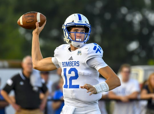 St. X quarterback Matthew Rueve attempts a pass against Colerain at the Skyline Chili Crosstown Showdown on Friday,  September 6, 2019 at Colerain High School in Colerain Township