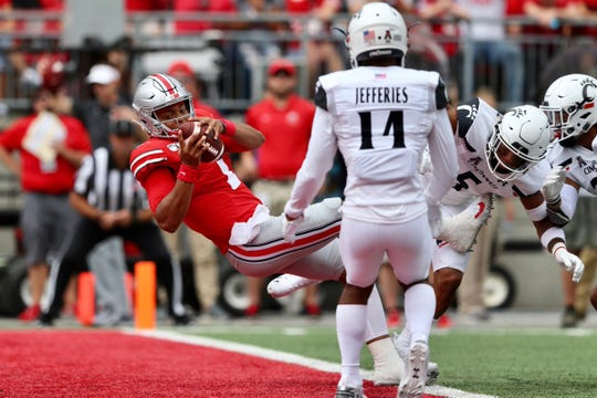 Ohio State quarterback Justin Fields scores a rushing touchdown against the University of Cincinnati in the first quarter, Sept. 7, 2019.