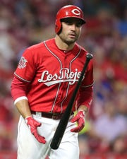 Cincinnati Reds first baseman Joey Votto (19) flips his bat after drawing a walk in the fifth inning of an MLB baseball game against the Arizona Diamondbacks, Friday, Sept. 6, 2019, at Great American Ball Park in Cincinnati.