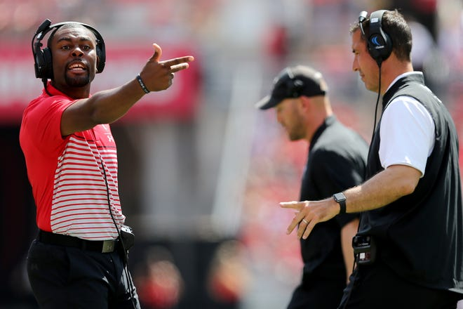 Cincinnati Bearcats cornerbacks coach and former player Mike Mickens, left, instruct the secondary in the fourth quarter of a college football game against the Ohio State Buckeyes, Saturday, Sept. 7, 2019, at Ohio Stadium in Columbus. The Ohio State Buckeyes won 42-0.