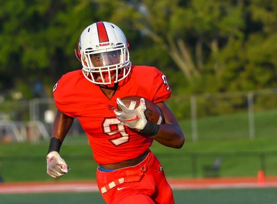 Colerain running back M.J. Flowers runs for a touchdown against the St. X Bombers during the Skyline Chili Crosstown Showdown on Friday,  Sept. 6, 2019 at Colerain High School in Colerain Township