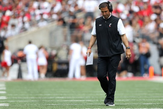 Cincinnati Bearcats head coach Luke Fickell walks on the field during a timeout in the second quarter of a college football game against the Ohio State Buckeyes, Saturday, Sept. 7, 2019, at Ohio Stadium in Columbus.