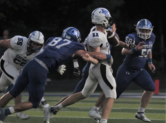 CovCath senior Michael Mayer gets his hands on LexCath senior QB Beau Allen and forces a fumble that CovCath would recover as Covington Catholic defeated Lexington Catholic 39-38 in football September 6, 2019 at Covington Catholic HS.