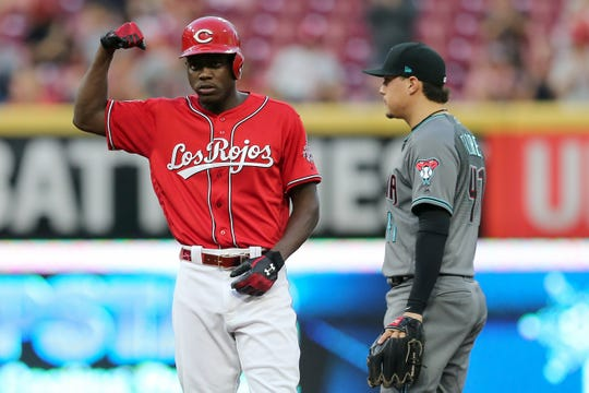 Cincinnati Reds right fielder Aristides Aquino (44) reacts after hitting a one-run double to score Cincinnati Reds shortstop Alex Blandino (2) (not pictured) in the first inning of an MLB baseball game against the Arizona Diamondbacks, Friday, Sept. 6, 2019, at Great American Ball Park in Cincinnati.