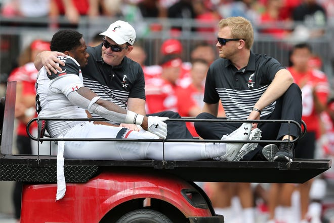 Cincinnati Bearcats safety Kyriq McDonald (26) is carted off the field after suffering an injury in the second quarter of a college football game against the Ohio State Buckeyes, Saturday, Sept. 7, 2019, at Ohio Stadium in Columbus.