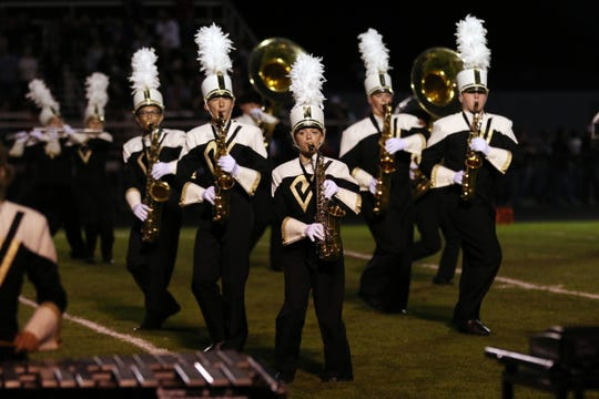 The River View marching bands perform at halftime of a recent football game. Marching band, football and other extra curricular activities could be scaled back, need more public help or be cut altogether if an income tax levy does not pass in the fall general election.