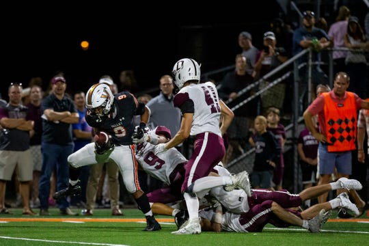 Valley's Creighton Mitchell (9) runs into the end zone giving Valley the lead during their football game at Valley Stadium on Friday, Sept. 6, 2019 in Des Moines. Valley would go on to defeat Dowling Catholic 29-22.